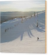 A Lone Skier Makes A Turn At Whitefish Wood Print