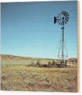 A Lone Windmill Stands On The Canadian Wood Print