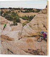 A Male And Female Mountain Biker Ride Wood Print