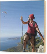 A Male Climber Looking At Paragliding Wood Print