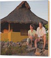 A Man And Woman Enjoy Sunset Wood Print
