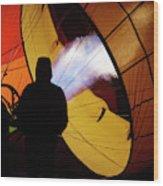 A Man As He Inflates A Hot Air Balloon Wood Print
