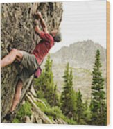 A Man Clinging To Rock Face In The Wood Print