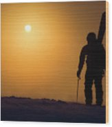 A Man Hikes Up A Mountain At Sunrise Wood Print