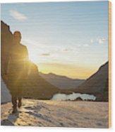 A Man Hiking On Snowfield At Sunrise Wood Print