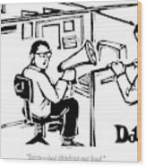 A Man Is Seated In His Cubicle With A Megaphone Wood Print