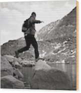 A Man Jumps From One Rock To Another Wood Print