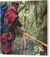 A Man Lowers A Rope For Canyoning Wood Print
