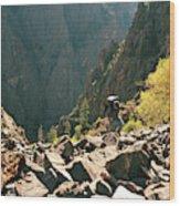 A Man Navigates A Rock Scree Field Wood Print