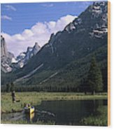 A Man Pulls His Canoe Up A River Valley Wood Print
