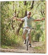 A Man Rides A Bicycle Wood Print