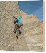 A Man Rock Climbing In Rocky Mountain Wood Print