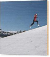 A Man Runs Alone On A Late Winter Day Wood Print