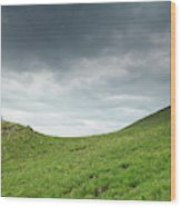 A Man Sitting On Top Of A Tundra Ridge Wood Print