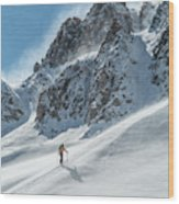 A Man Ski Touring In The Mountains Wood Print