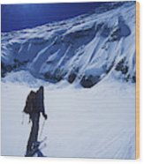 A Man Ski Touring Under Blue Skies Wood Print