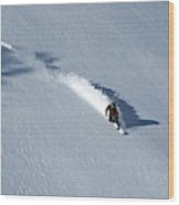 A Man Snowboards Down A Slope On Teton Wood Print
