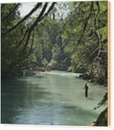 A Man Stands In A River Wearing Waders Wood Print