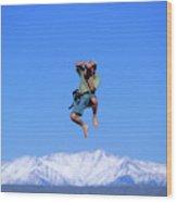 A Man Takes A Photo While Jumping Wood Print