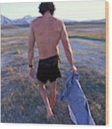 A Man Takes Off His Clothes And Walks Wood Print