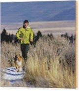 A Man Trail Runs On A Winter Day Wood Print