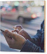 A man uses a mobile phone at Shibuya crossing Wood Print