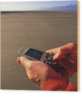 A Man Using A Gps Device At Sunset Wood Print