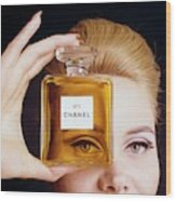 A Model Holding A Bottle Of Perfume Wood Print