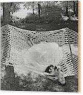 A Model Lying On A Hammock Wood Print