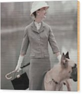 A Model Wearing A Gray Suit With A Dog Wood Print