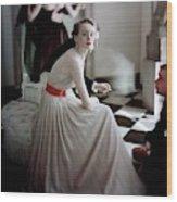 A Model Wearing A Harry Keiser Dress Wood Print