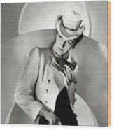 A Model Wearing A Jacket And Hat Wood Print