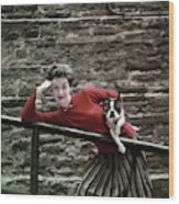 A Model With A Dog Leaning On A Railing Wood Print