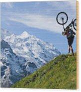 A Mountain Biker Is Carrying His Bike Wood Print