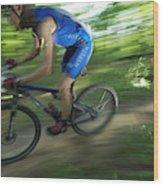 A Mountain Biker Races On A Trail Wood Print
