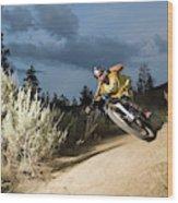 A Mountain Biker Rides A Trail Wood Print