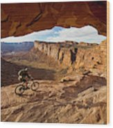 A Mountain Biker Rides By On Slickrock Wood Print
