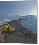 A Mountaineer Contemplates The Sun Wood Print