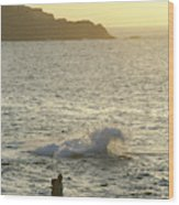 A Person Hiking On Rocky Shore Wood Print