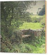 A Quaint Stone Bench, This Seat Is Built Into A Bridge Wood Print
