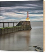 A Red And White Striped Lighthouse Wood Print