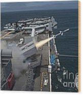 A Rim-7 Sea Sparrow Missile Is Launched Wood Print by Stocktrek Images