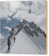 A Rope Team Climbs A Ridge Wood Print