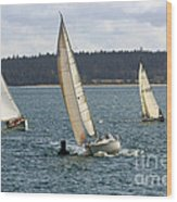 A Sailing Yacht Rounds A Buoy In A Close Sailing Race Wood Print