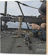 A Sailor Fires An M-240b Machine Gun Wood Print by Stocktrek Images