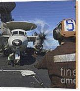 A Sailor Signals To Pilots Of An E-2c Wood Print
