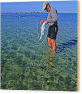 A Salt Water Fly Fisherman Catches Wood Print