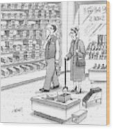 A Shoe Salesman Browses The Selection Of Shoes Wood Print