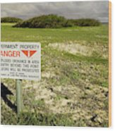 A Sign Warns Of Dangerous Unexploded Wood Print