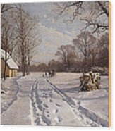 A Sleigh Ride Through A Winter Landscape Wood Print by Peder Monsted
